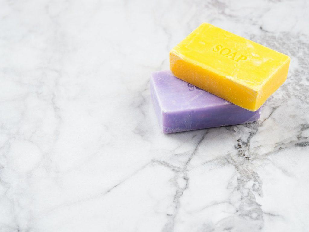 Lemon and lavender artisanal soap bars on marble
